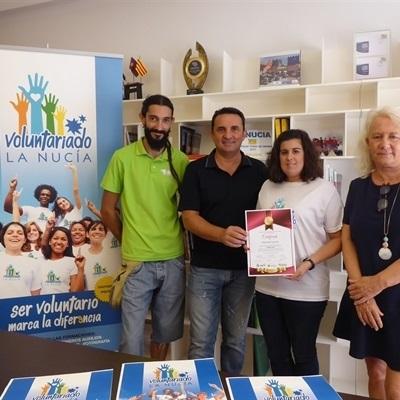 Reconocimiento a la voluntaria con diversidad funcional  de l'Escola d'Estiu